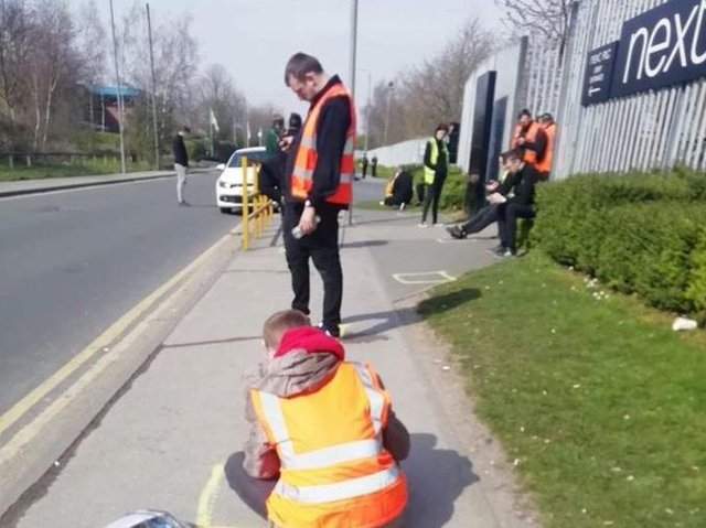 One picture circulating on social media showed workers having to take lunch on the pavement outside.