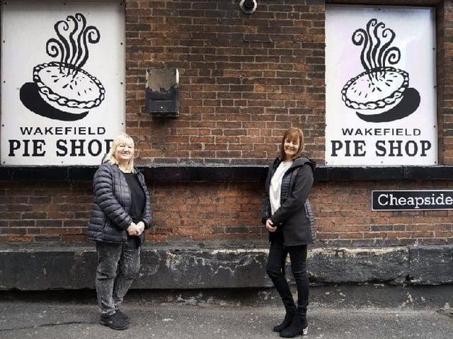 Colleagues Sharon Devonport and Karen Eccleston outside the shop.