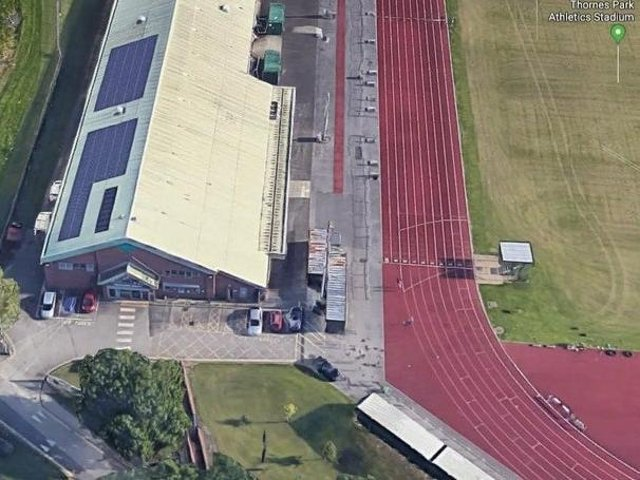 The pitch was originally going to be located inside the running track, prompting concerns from Wakefield Harriers members.