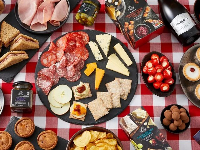 The Family Picnic Food Box features everything you need to whip up a stellar picnic in no time; from sandwiches, to snacks and drinks.
