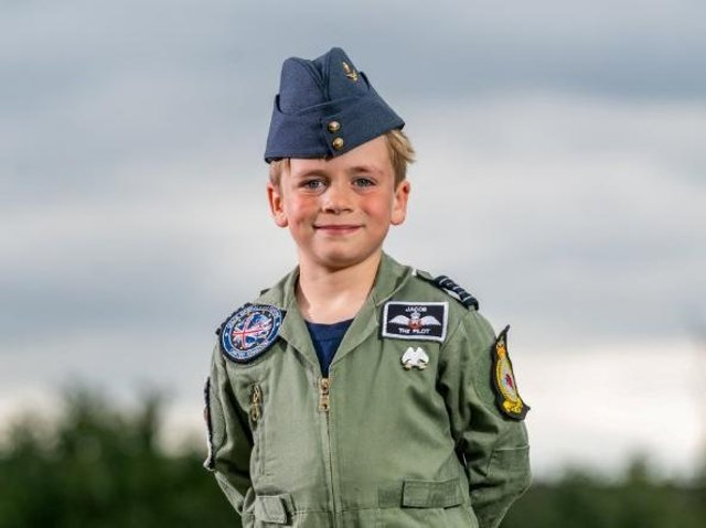 Seven-year-old RAF-obsessed Jacob Newson, whose mother passed away from breast cancer last year, has taken to the sky for his first 'flying lesson'.