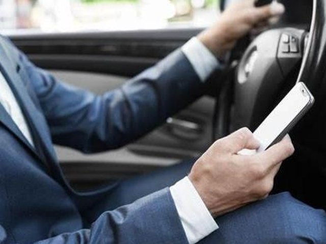 While there has been a ban on using a handheld device while driving for the past 18 years, the Government is looking to crack down on the issue by introducing a £200 fine, as well as six penalty points, for anyone who breaks this law. The law also includes vehicles that are waiting at traffic lights or at a complete standstill. If you wish to use your mobile phone while in your car, you need to park up where it is safe to do so. This update will also cover a significant loophole in the previous law which couldn't penalise drivers for taking photos or videos while driving.