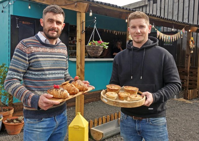 Josh Wright and Luke Andrew in front of the recently-built stall. (photo David Pickersgill)
