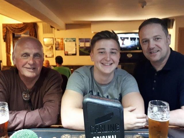 Family affair: John with his grandson Matty and son, Jonnny.