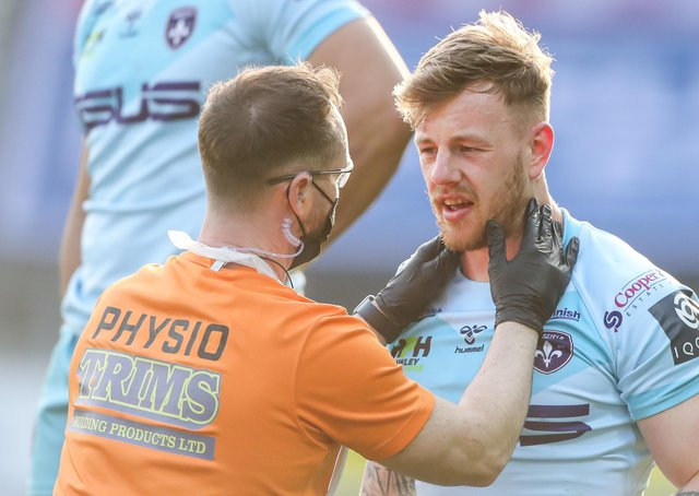 Waiting game: Wakefield's Tom Johnstone is checked out after being injured against Wigan. Picture by Alex Whitehead/SWpix.com