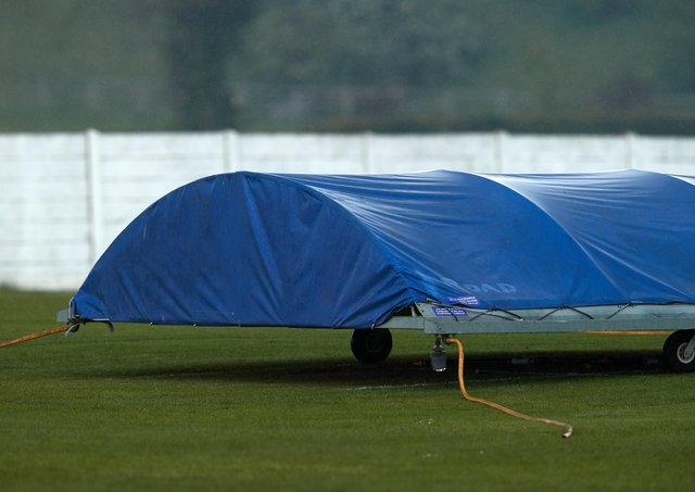 The covers go on as Altofts' game is abandoned. The scene was the same at most grounds last Saturday. Picture: John Clifton
