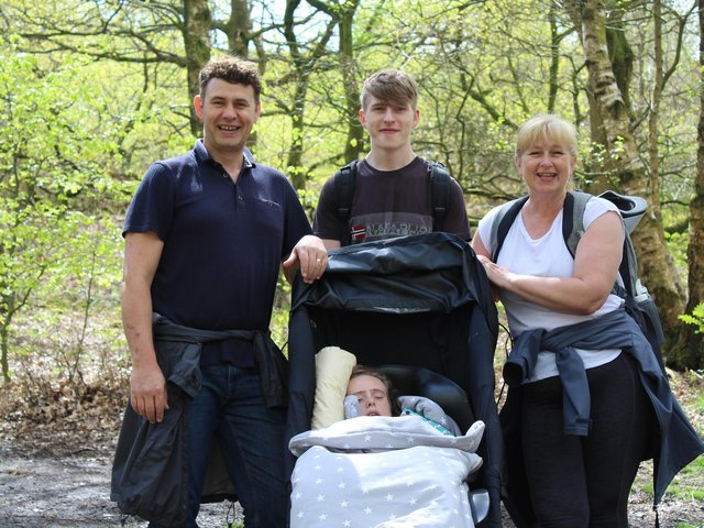 Lee, Elliot and Julie pictured with Holly - all in training for their climb up Pen-y- ghent