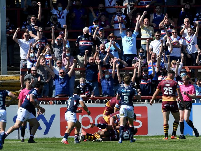 Trinity players and fans celebrate Joe Westerman's try against Giants. Picture by Simon Hulme.
