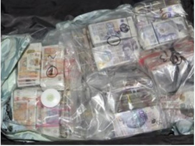 The cash found in the suitcases at Heathrow.