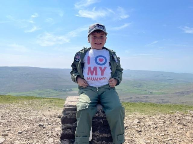 Little Jacob Newson, 7, climbed Ingleborough, Whernside and Pen-y-Ghent in the Yorkshire Dales in just under five hours.