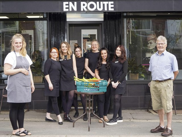 Lauren Crowther from Whisk cafe, staff from En Route and allotment chairman Alan Berry.