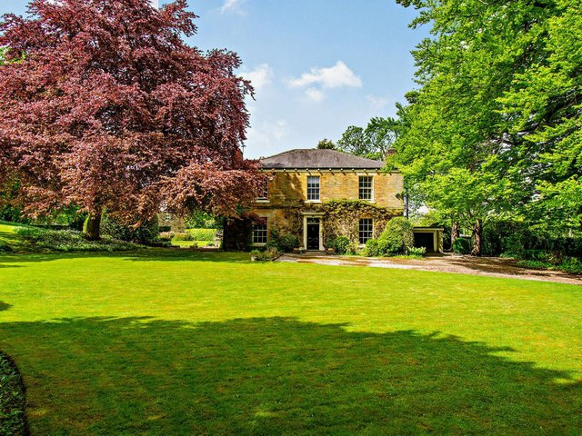 The gardens and grounds of Calder Grove House include many varied trees and shrubs