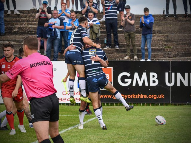 Featherstone players celebrate during their win over Widnes