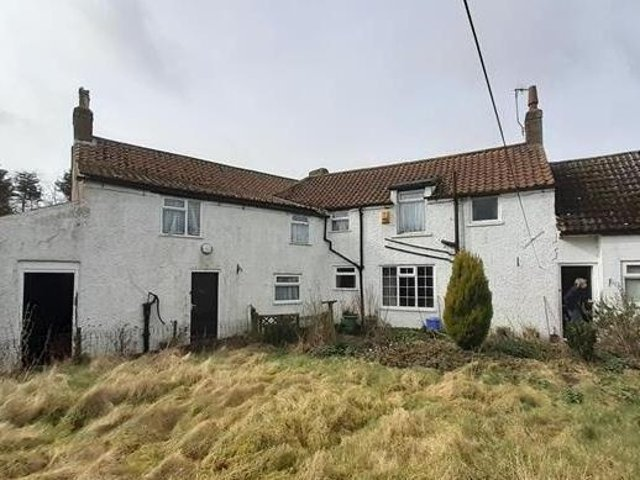 The four-bedroom farmhouse close to one of Yorkshire's best-loved beaches is to be put up for auction next month with a guide price of £160,000.