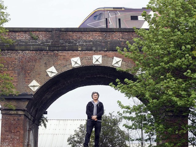 You've walked past them, driven under them and maybe even taken a train along the top of them. But how much do you really know about Wakefield's 99 Arches? Artist Tony Wade is seen under one of the arches. Photo: Scott Merrylees