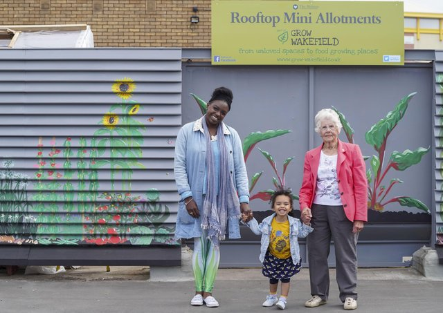Grow Wakefield's oldest member Ann Tomlinson and youngest member Rose Timmerman with artist Hoshi Dee at the unveiling of a new mural at The Ridings Rooftop Mini Allotments. Picture Scott Merrylees