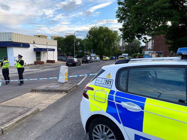 Two men have been rushed to hospital and remain in a critical condition after a stabbing on a Wakefield street. Police are seen on Upper Warrengate, Wakefield, last night.