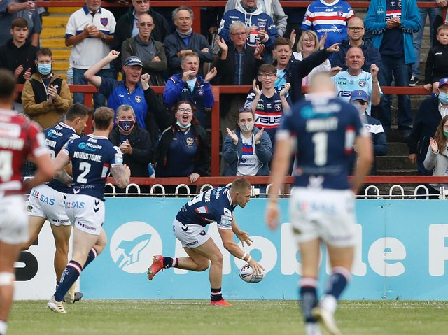 Picture by Ed Sykes/SWpix.com - 24/06/2021 - Rugby League - Betfred Super League Round 11 - Wakefield Trinity v Wigan Warriors - The Mobile Rocket Stadium, Wakefield, England - Wakefield Trinity fans celebrate as Ryan Hampshire scores their first try