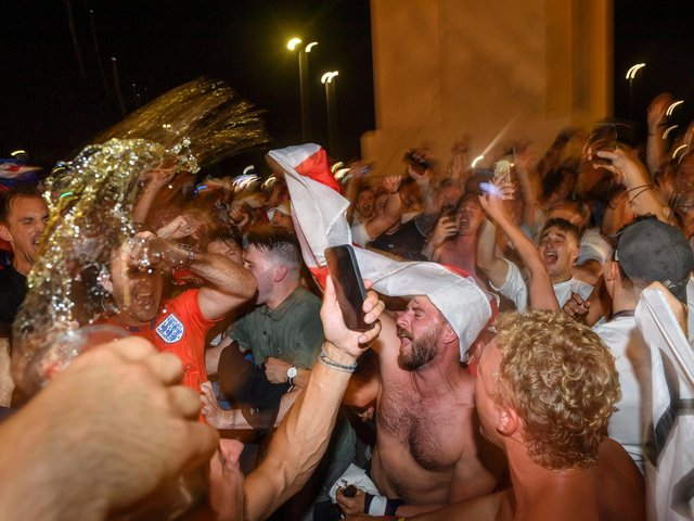ENGLAND FANS: Celebrating after a win. Photo: Getty Images