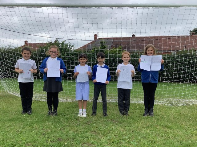 Pupils from Ossett South Parade Primary School show off their letters of support for the England football team. Photo: Ossett South Parade Primary School